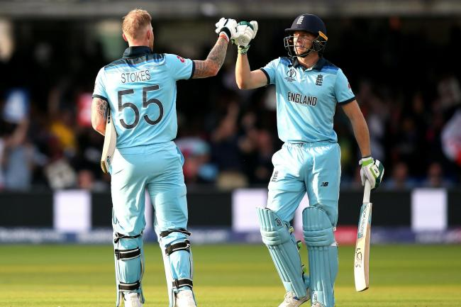 England's Ben Stokes and Jos Buttler, right, after the super over