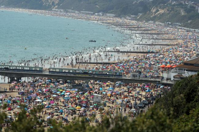 IN PICTURES: Thousands flock to Bournemouth beach today