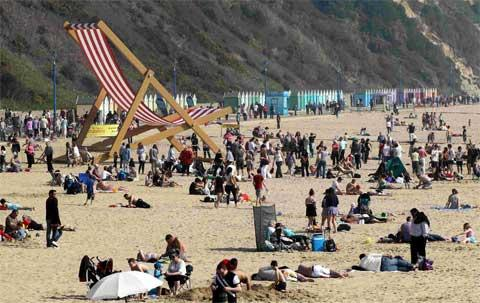 HOTTER THAN FRANCE AND SPAIN:  Sunbathers bask on Bournemouth Beach