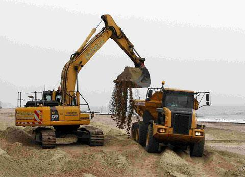 BIG JOB: Thousands of tonnes of sand  are shifted from Southbourne beach