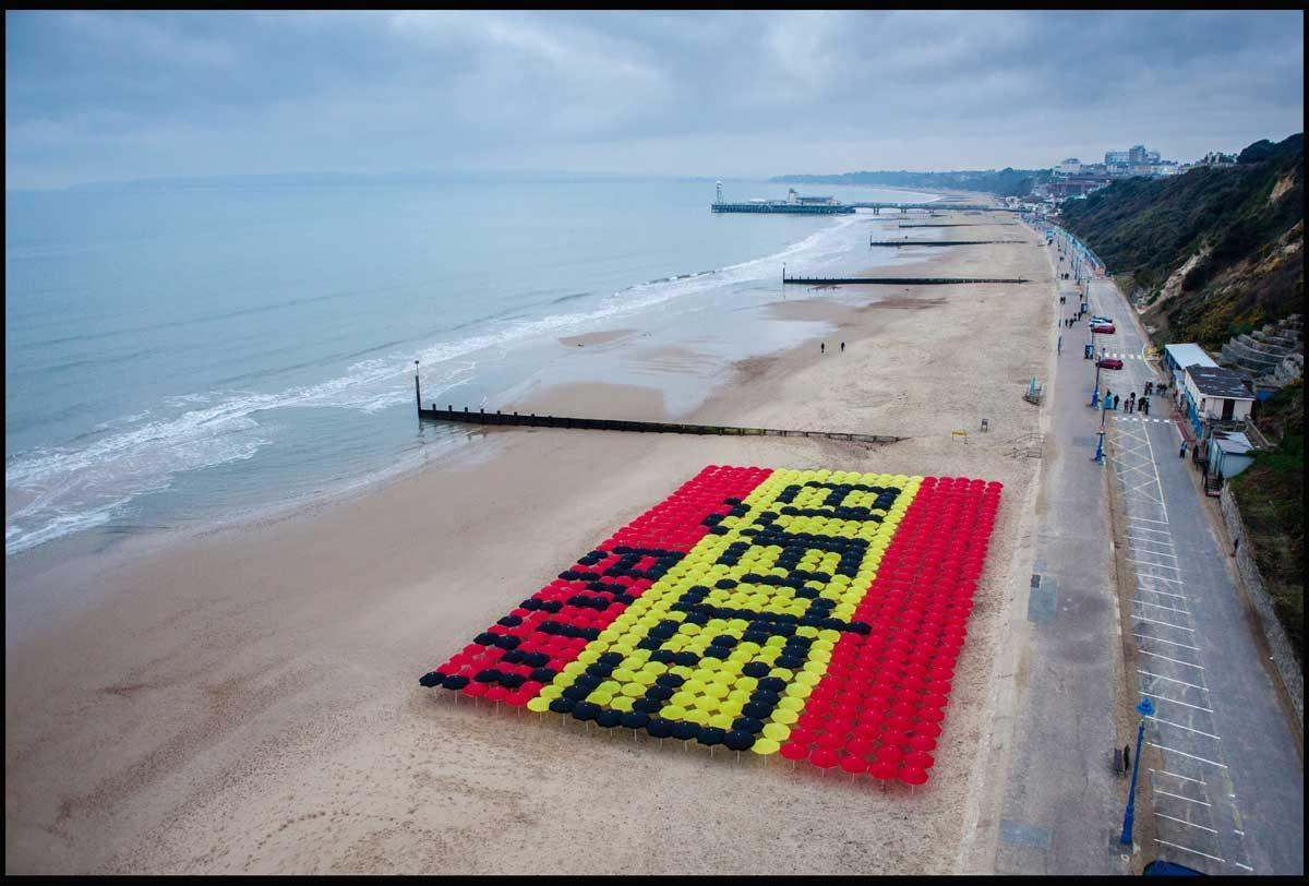 Three UK commissioned this giant Spanish flag made up of over 600 parasols on Bournemouth beach