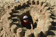 KING OF THE  CASTLE: Aaron, four, from High Wycombe, in his sandcastle on Bournemouth sands