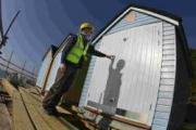 SHED LOADS: Edwin Sadd from Poulton Portables checks the Alum Chine huts