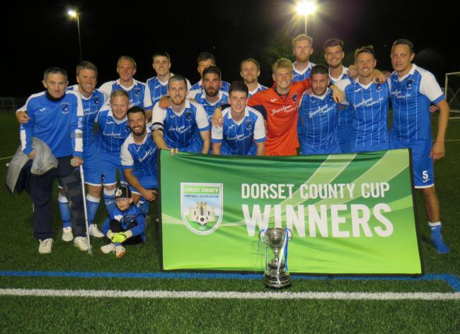 TROPHY TIME: Merley Cobham Sports celebrate their Dorset Senior Trophy win 	                   Picture: DORSET FA